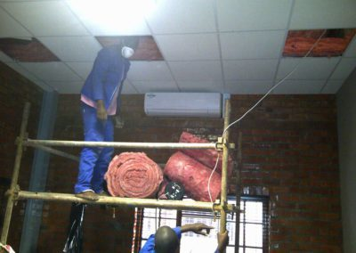 roof-insulations-installing-insulation-above-suspended-ceiling