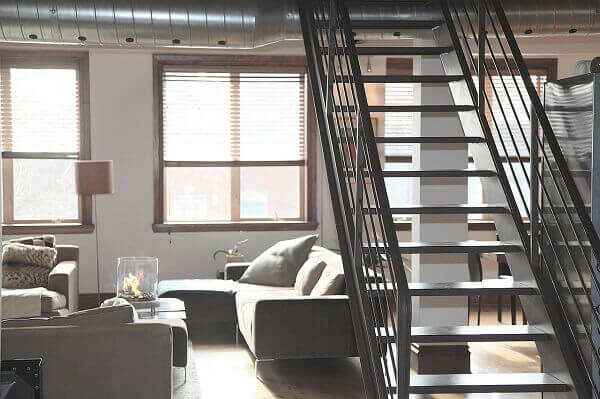 A living room with a staircase