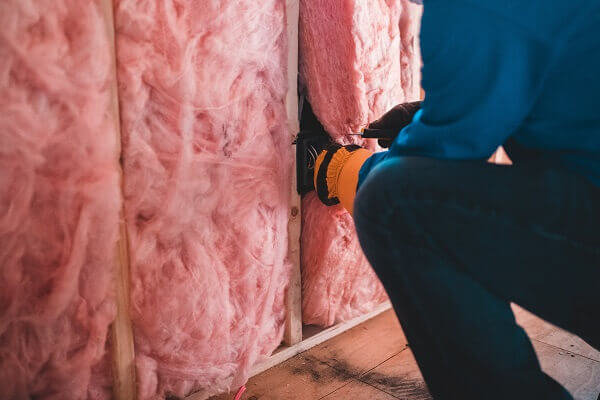 Man working on home insulation